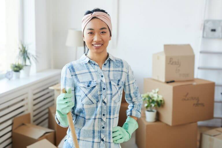 Young Asian Woman Posing with Cleaning Tools in New House